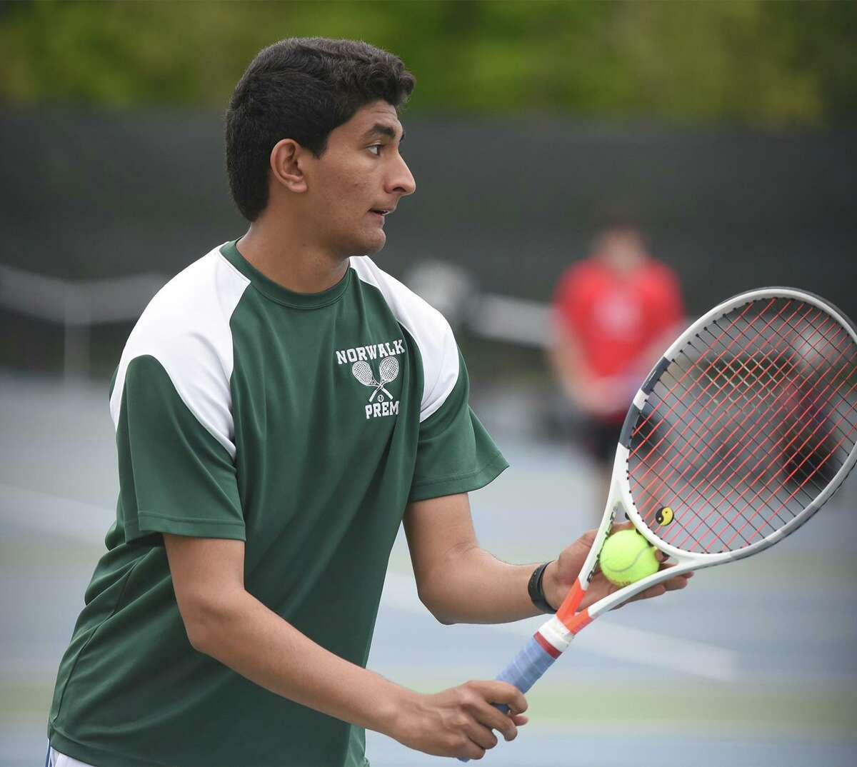 Norwalk's Prem Dave gets set to serve during a match in New Canaan on May 10.