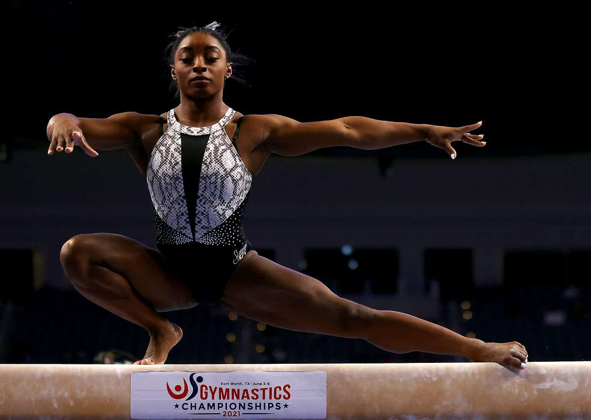 Simone Biles warms up on the beam prior to the Senior Women's competition of the U.S. Gymnastics Championships at Dickies Arena on in Fort Worth, Texas. She earned a record seventh U.S. title in the event.