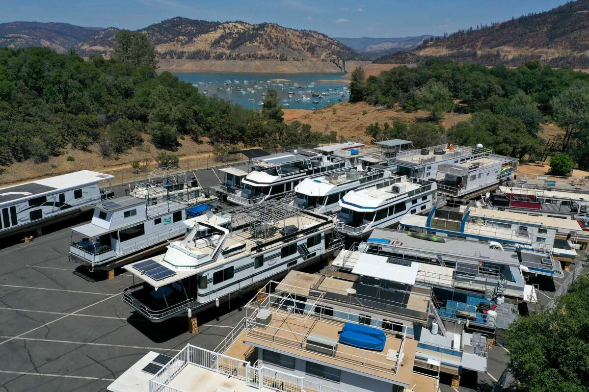 In an aerial view, houseboats sit in the Bidwell Canyon Marina parking lot at Lake Oroville on June 1, 2021, in Oroville, Calif. As water levels continue to fall at Lake Oroville, officials are flagging houseboats that are anchored on the lake for removal to avoid being stuck or damaged. Lake Oroville is currently at 38% of normal capacity. According to the U.S. Drought Monitor, 16% of California is in exceptional drought, the most severe level of dryness.