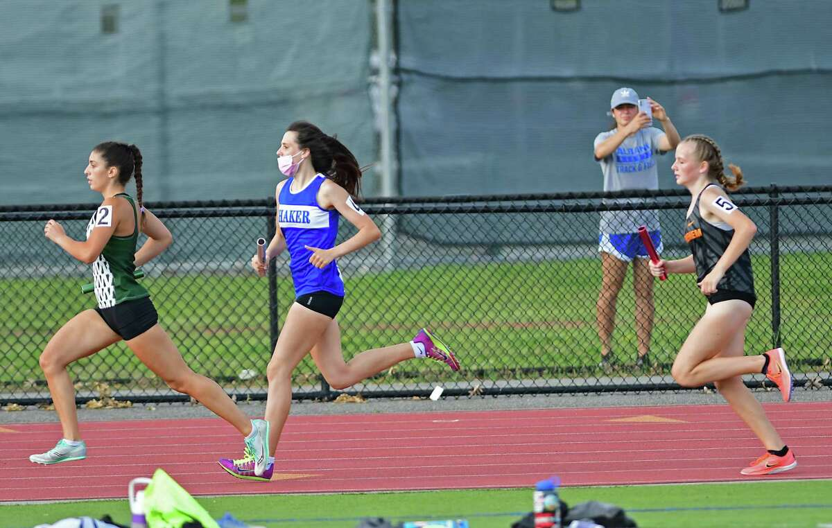 Athletes participate in the 4 x 800 relay during a Group 1 championship track meet at Shenendehowa High Schoo on Monday, June 7, 2021 in Clifton Park, N.Y. Temperatures were in the 90's during the meet. (Lori Van Buren/Times Union)
