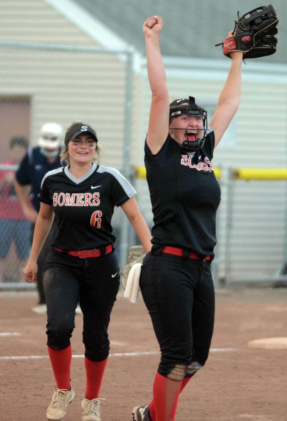 Somers pitcher Emily Reynolds celebrates after final out was recorded in a Class S semifinal win over Shepaug on Monday.