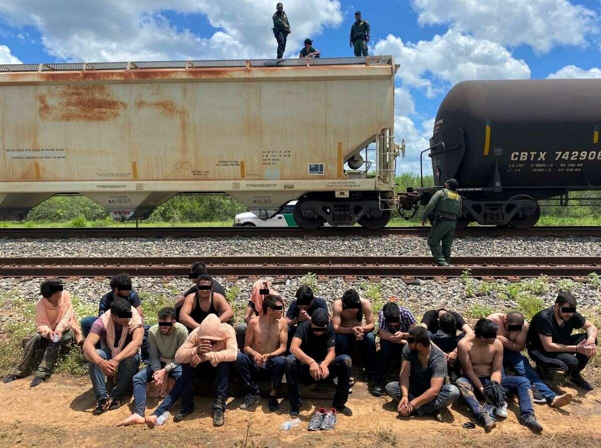 U.S. Border Patrol agents said they rescued 25 migrants from inside grain hopper rail car.
