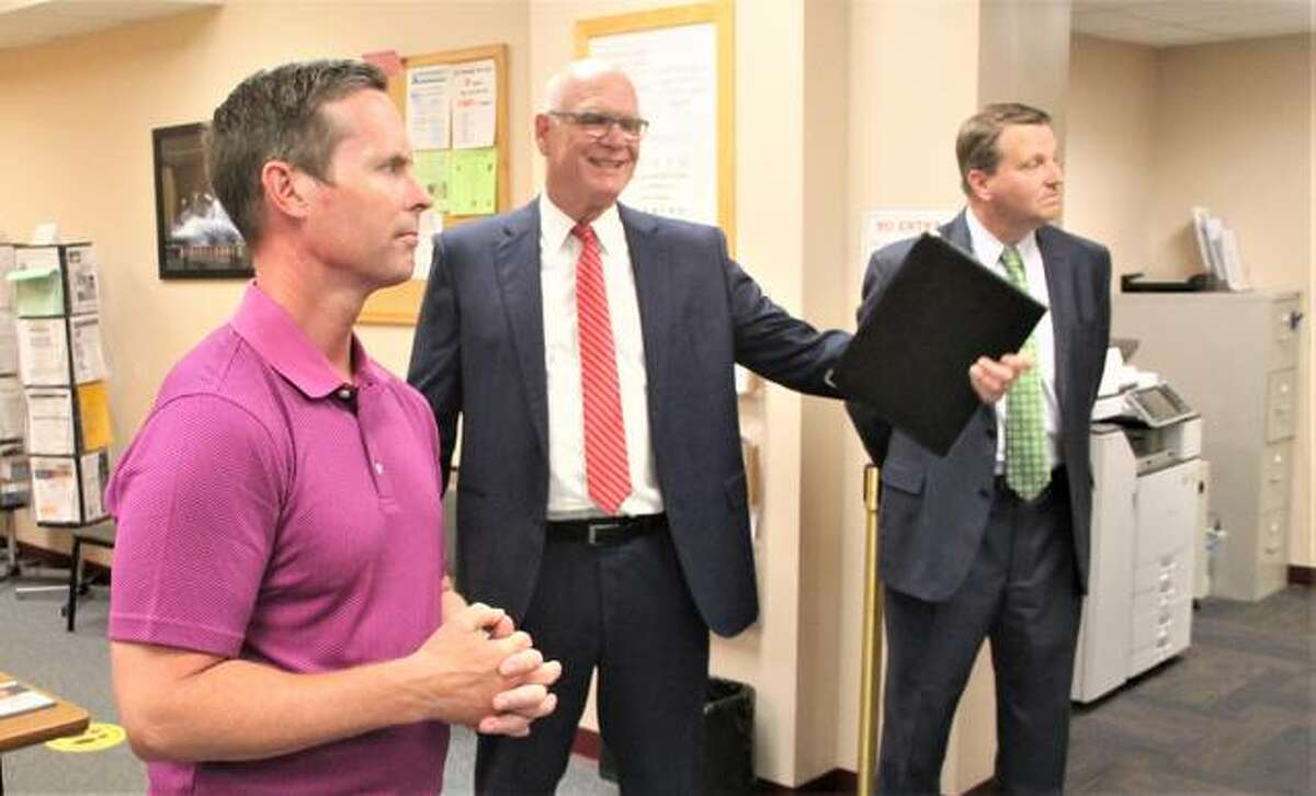 U.S. Rep. Rodney Davis, R-Taylorville, is given a tour of the Madison County Employment & Training office in Wood River Friday by Director Tony Fuhrmann, also participating in the tour was Madison County Administrator Dave Tanzyus.