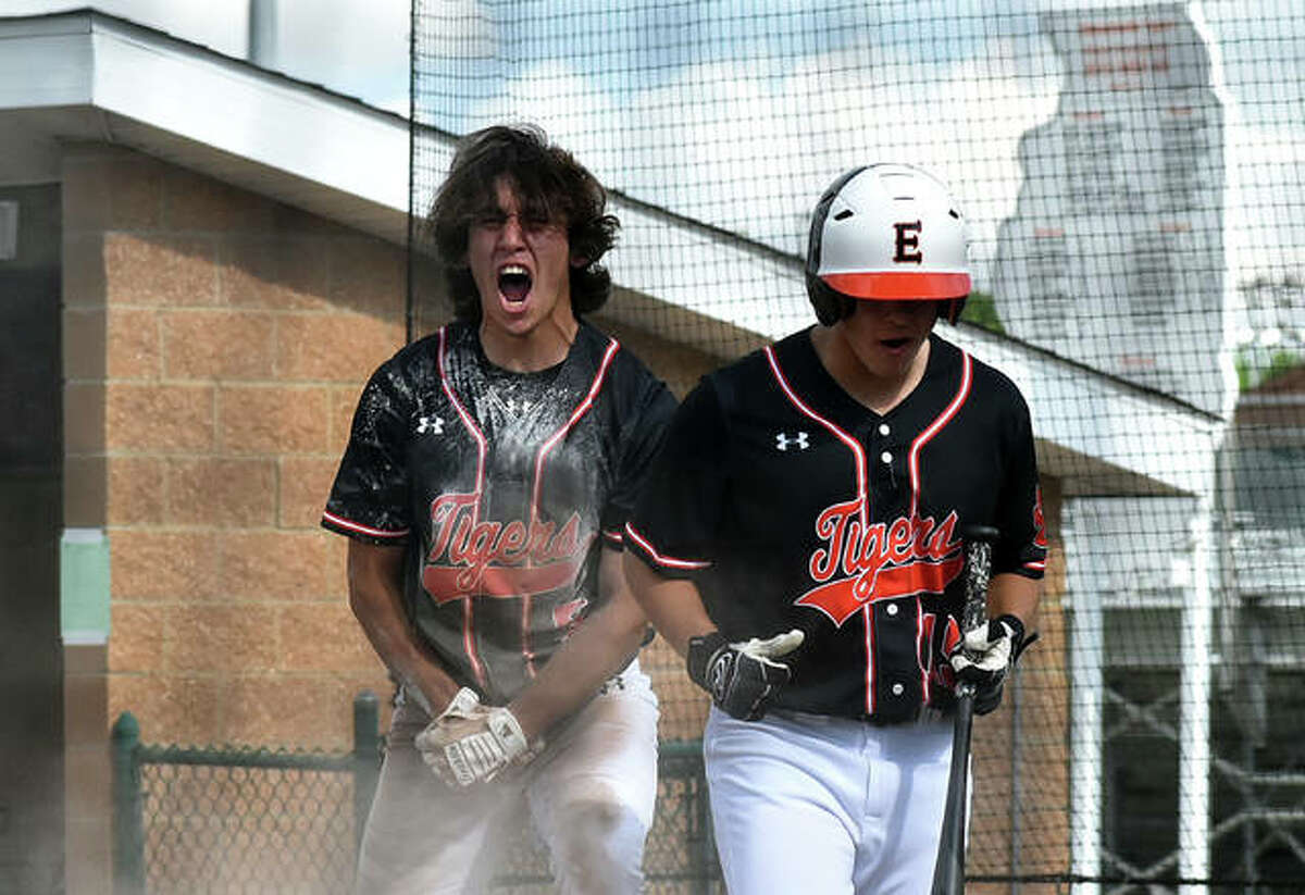Edwardsville's Ty Berumen, left, celebrates after scoring the first run of the game in the second inning of the Class 4A regional championship game.