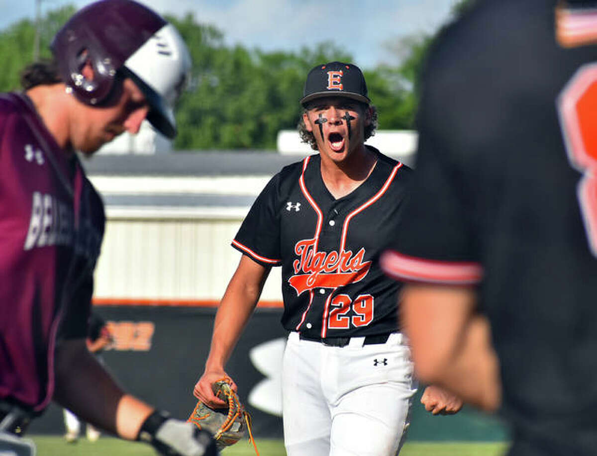 Edwardsville's Spencer Stearns lets out a scream as he walks off the mound in the sixth inning.