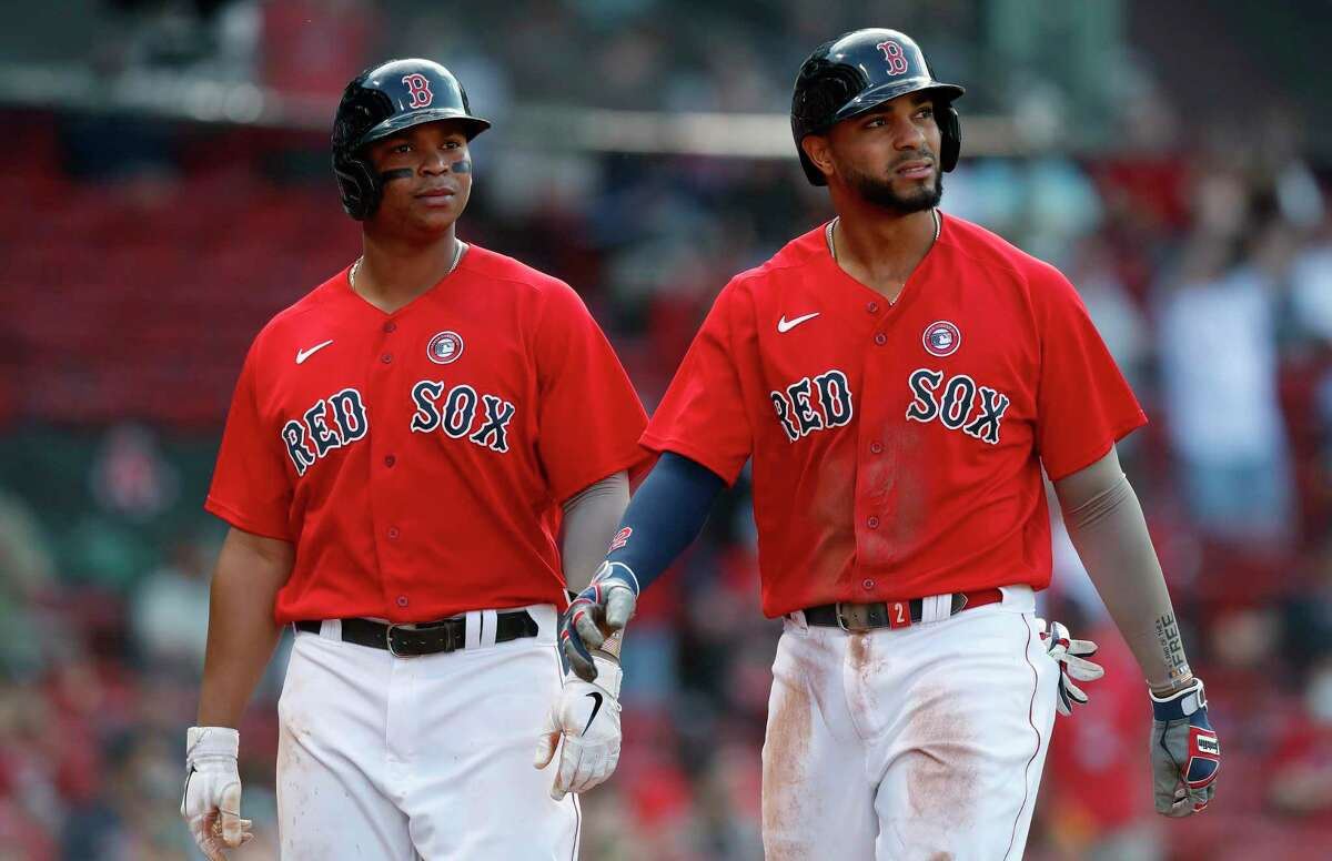 Red Sox third baseman Rafael Devers, left, and shortstop Xander Bogaerts lead the American League in a number of categories at their respective positions.