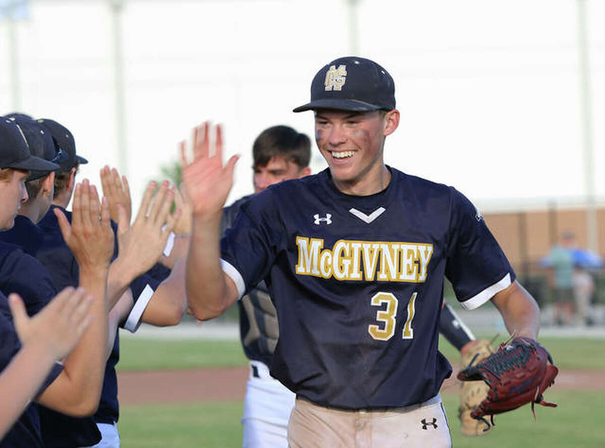 Father McGivney's Jackson Rodgers hits the Griffins high-five line after pitching a 1-2-3 seventh in his only inning of relief Monday after McGivney's Class 1A regional championship win over Metro-East Lutheran in Glen Carbon.