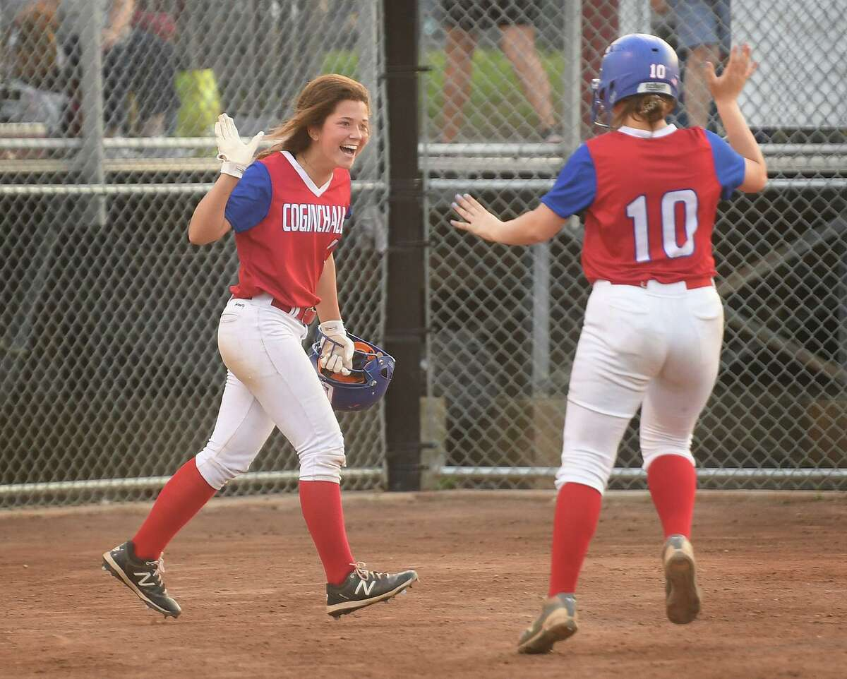 Coginchaug teammates Alayna Mariani, left, and Dana Boothroyd celebrate a run in the 4th inning of their Class S semifinal game with Notre Dame of Fairfield at DeLuca Field in Stratford, Conn. on Monday, June 7, 2021.