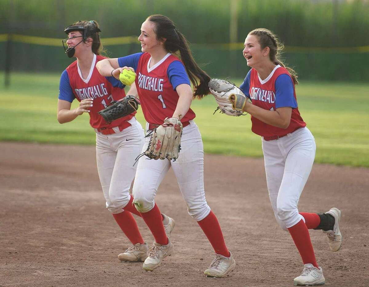 Coginchaug centerfielder Jackie Kelly, center, is congratulated by her teammates after making a diving catch in the 1st inning of their Class S semifinal game with Notre Dame of Fairfield at DeLuca Field in Stratford, Conn. on Monday, June 7, 2021.
