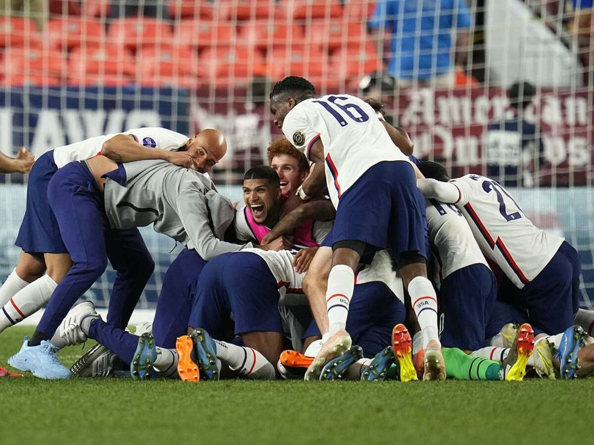 United States teammates celebrate a 3-2 win against Mexico in extra time in the CONCACAF Nations League championship soccer match, Sunday, June 6, 2021 in Denver.