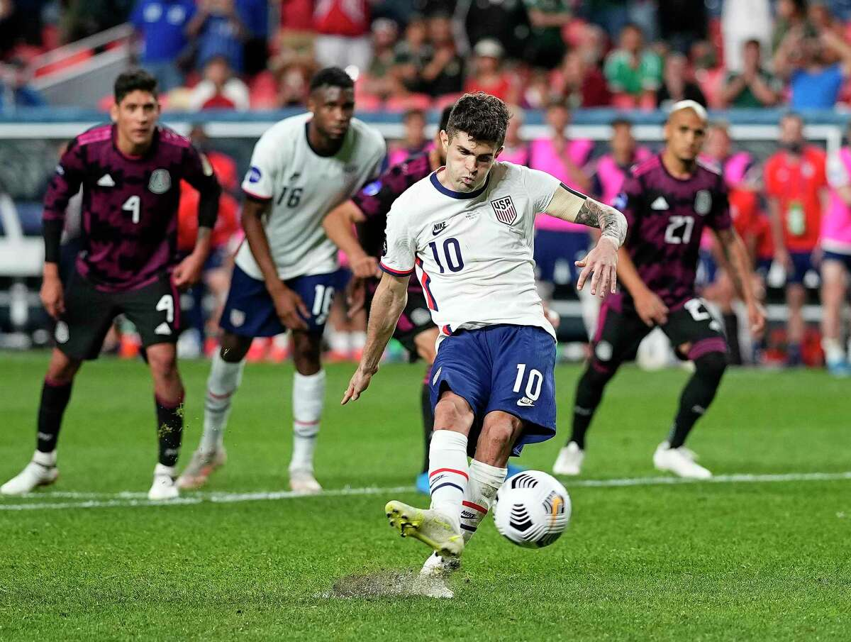 Christian Pulisic scores what proved to be the winning goal off a penalty kick in extra time in the United States' 3-2 victory over Mexico in the CONCACAF Nations League championship match Sunday, June 6, 2021 in Denver.