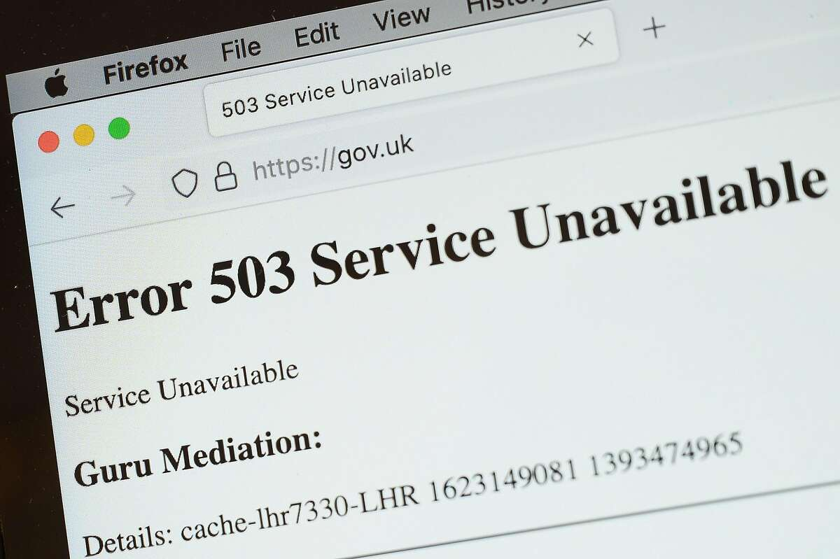 In this Photo illustration, a screen displays a holding page of the Gov.UK Government website portal on June 08, 2021 in London, England. A wide range of major websites including eBay, Paypal, The Financial Times, Reddit, Twitch and The Guardian were taken offline due to what is believed to be an issue with the Fastly cloud hosting service. Some of the affected websites displayed the message