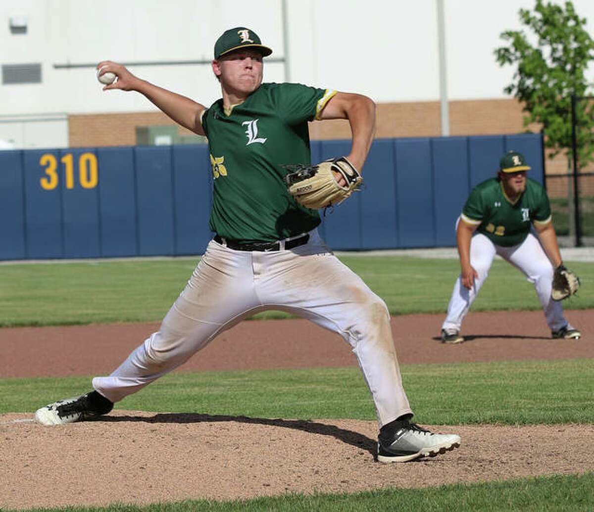 Metro-East Lutheran pitcher Erik Broekemeier delivers a pitch to a Father McGivney hitter during a Class 1A regional championship game on Monday.