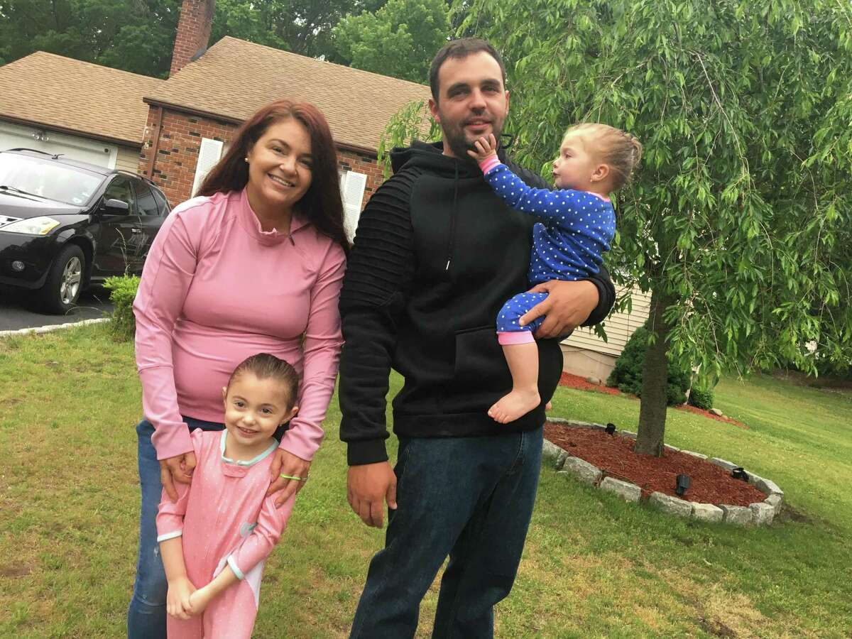 The Teixeiras -- Elizabeth, left, Luis, Skyler, 18 months, and Avery, 4, of West Haven on Thursday, June 3, 2021.