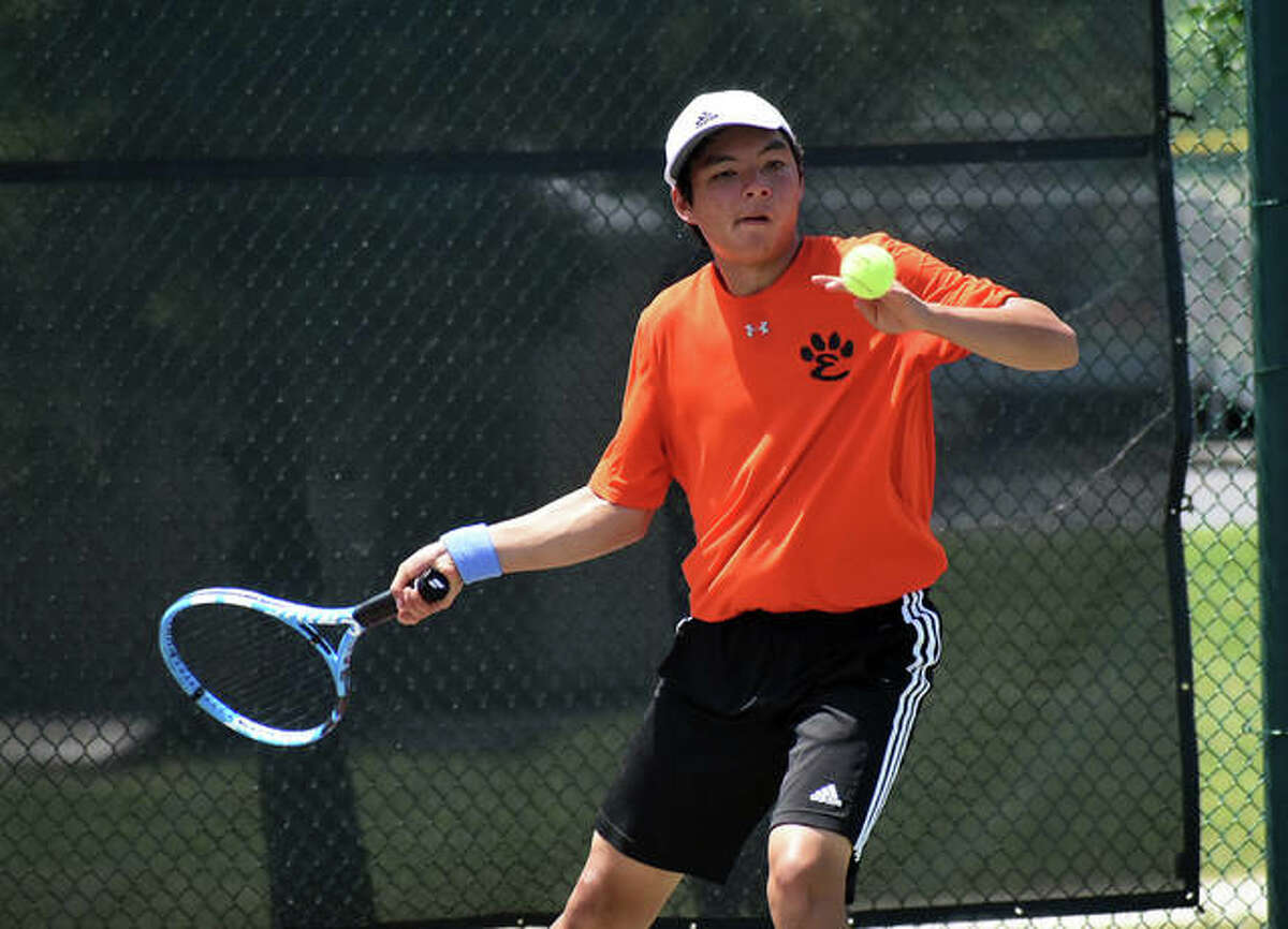 Edwardsville's Jade Dynamic hits a return shot during his doubles final match with Michael Karibian at the Class 2A Belleville West Sectional.
