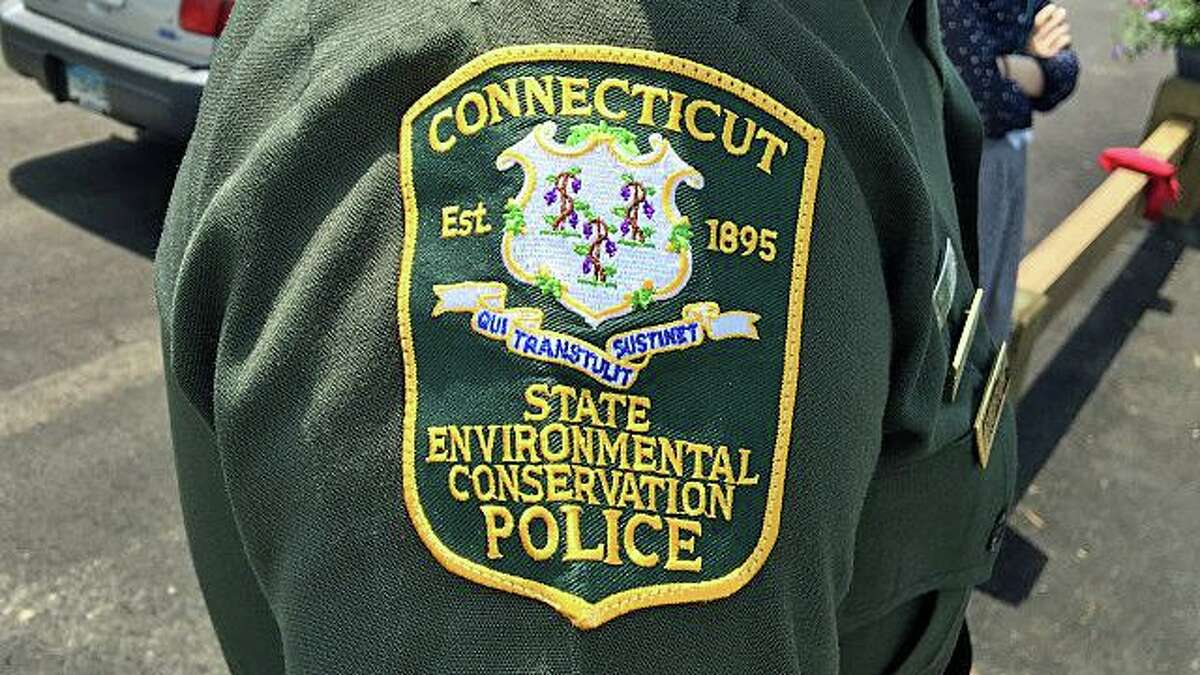 Environmental Conservation Police with the state Department of Energy and Environmental Protection responded to Winchester Lake after fire officials alerted the agency that crews recovered a male body near an overturned canoe in Winchester, Conn., on Tuesday, June 8, 2021.