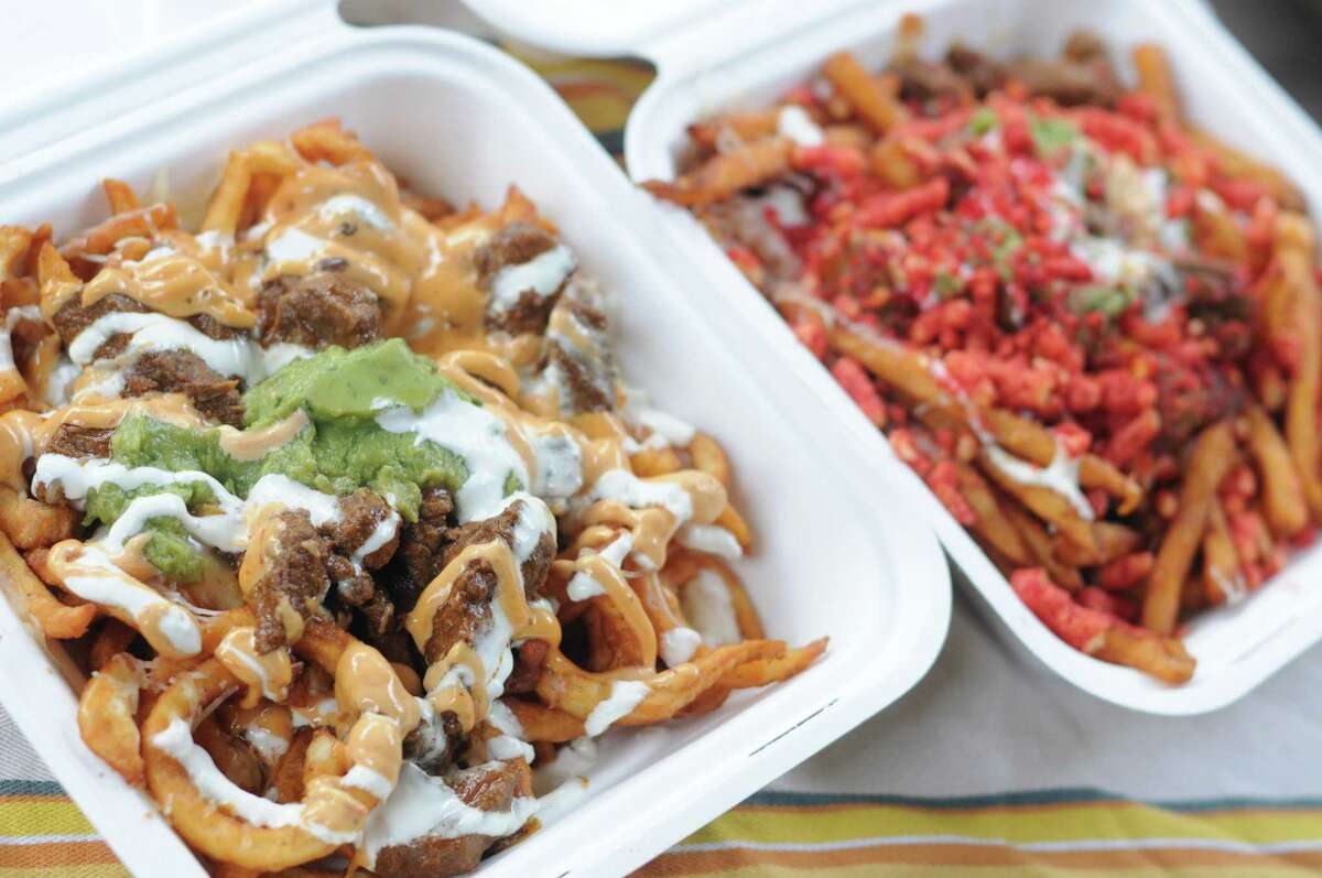 NorCal (left) and SoCal Fries loaded with carne asada, guacamole, cheese and more from Man vs Fries