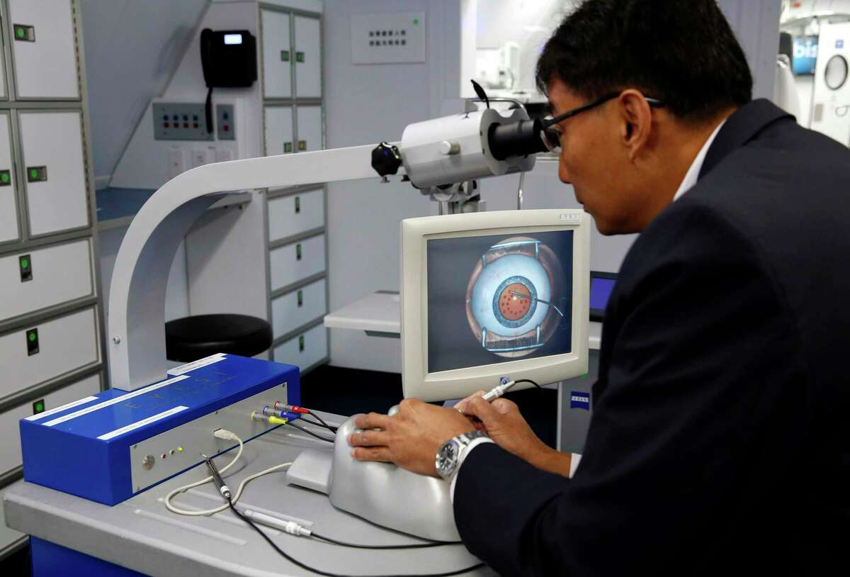Ronald Gyi demonstrates a cataract surgery with the Eyesi Ophthalmosurgical Simulator on the Orbis Flying Eye Hospital at Moffett Federal Airfield in Mountain View, California.