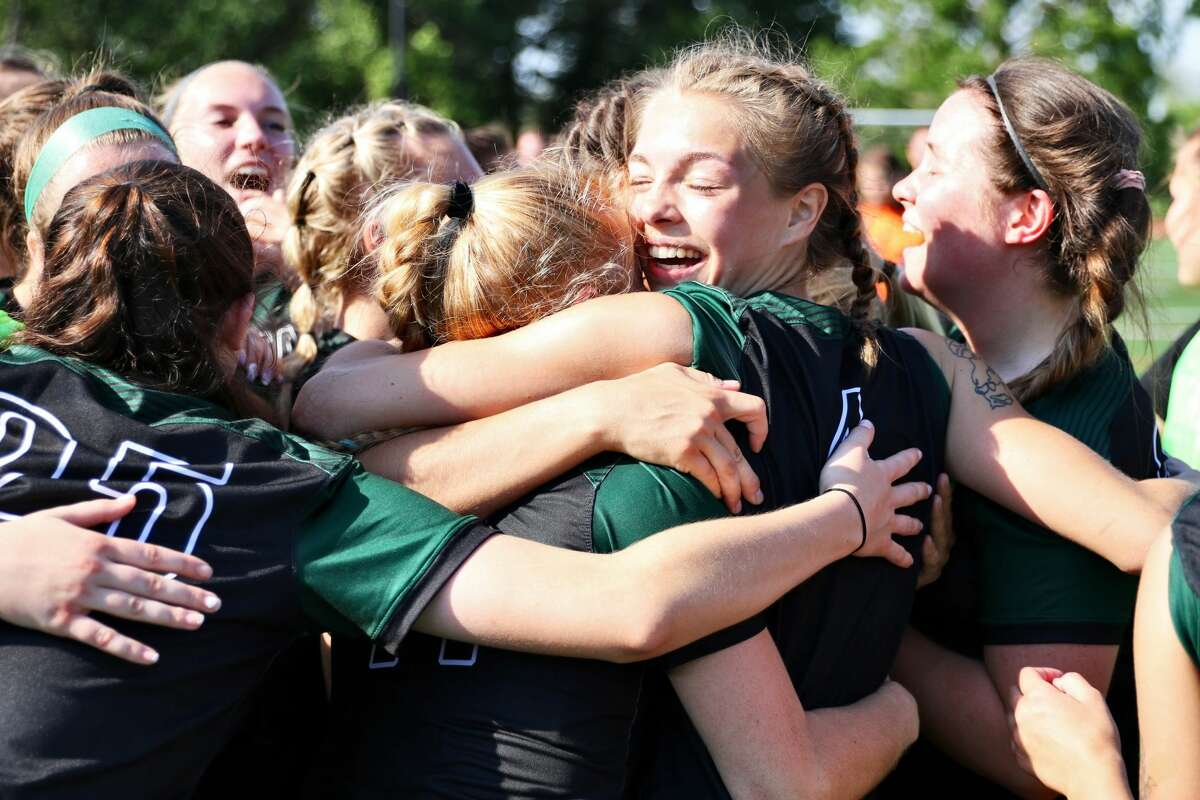 Delta College's women's soccer team celebrates following Saturday's NJCAA Division III national championship game.