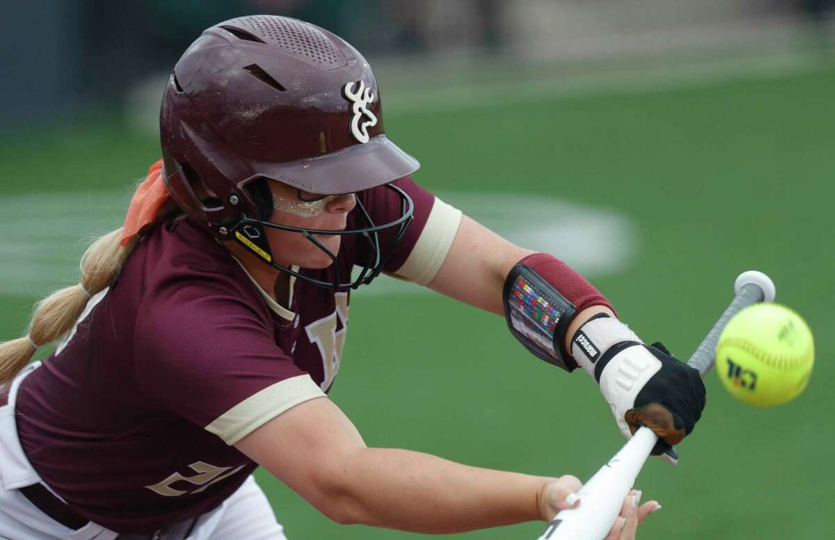Tabby Bailey #21 of Deer Park bunts the ball in the first inning of a Class 6A state semifinal game, Friday, June 4, 2021, in Leander.