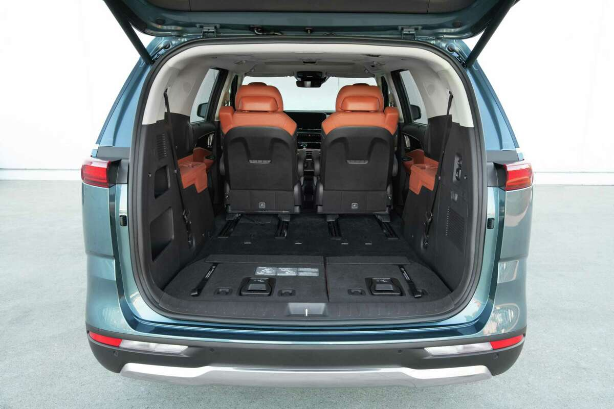 Kia's 2022 Carnival is a spacious and quiet ride that offers three rows of seating and can accomodate up to eight passengers.