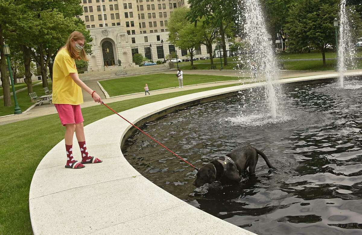 Ivan (who chose not to give his last name) lets his dog Blue cool down in a fountain in West Capitol Park on Tuesday, June 8, 2021 in Albany, N.Y. (Lori Van Buren/Times Union)