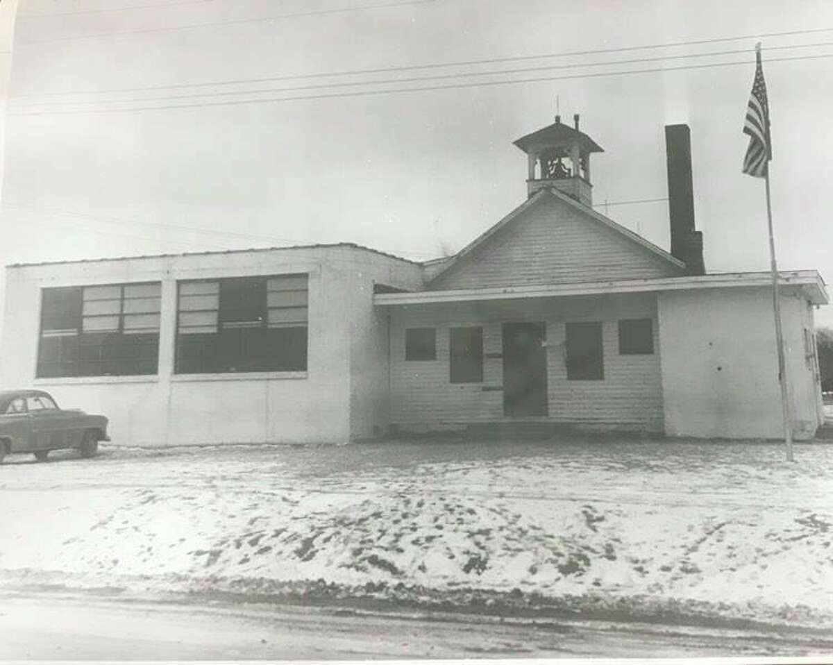 The original Cady school, with school bell on Sturgeon Road. Cady had two additions since the building was first constructed. January 1956