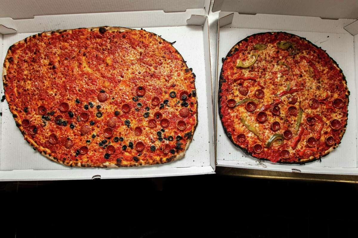 A large and medium-size pizza at Sally's Apizza in New Haven.