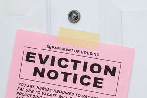 Pink Eviction Notice Taped on Front Door.