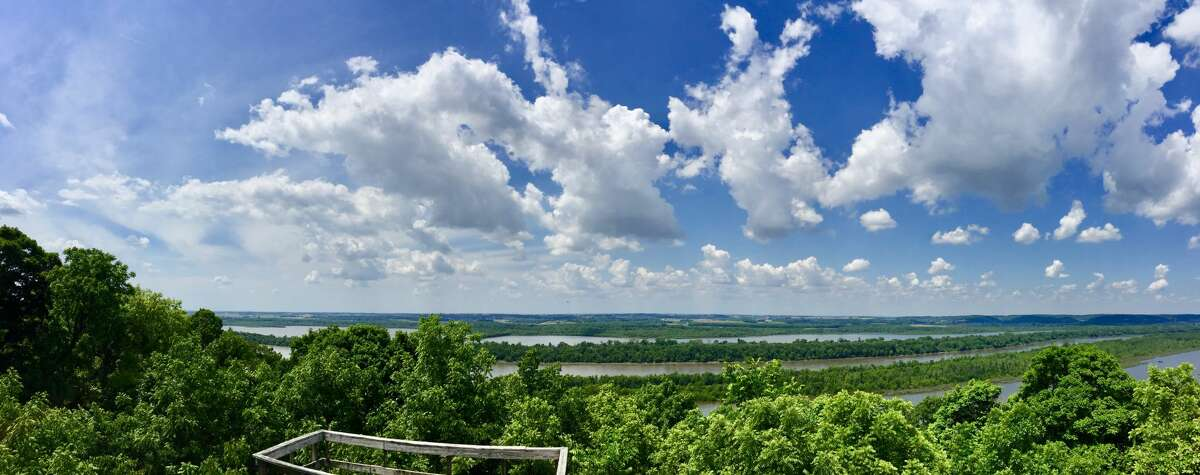 A panoramic view from McAllen Peak. Off in the distance is the Illinois River bordered by two lakes.