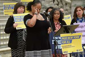 Columbia County Sanctuary Movement member Dalila Yeend wipes tears from her eyes while she speaks as legislators and immigrants' rights advocates urgently work to pass the New York for All Act on Tuesday, June 8, 2021 in Albany, N.Y. The bill prohibits New York's state and local government agencies, including police and sheriffs, from conspiring with ICE, including disclosing sensitive information and diverting personnel or other resources to support federal immigration enforcement. (Lori Van Buren/Times Union)