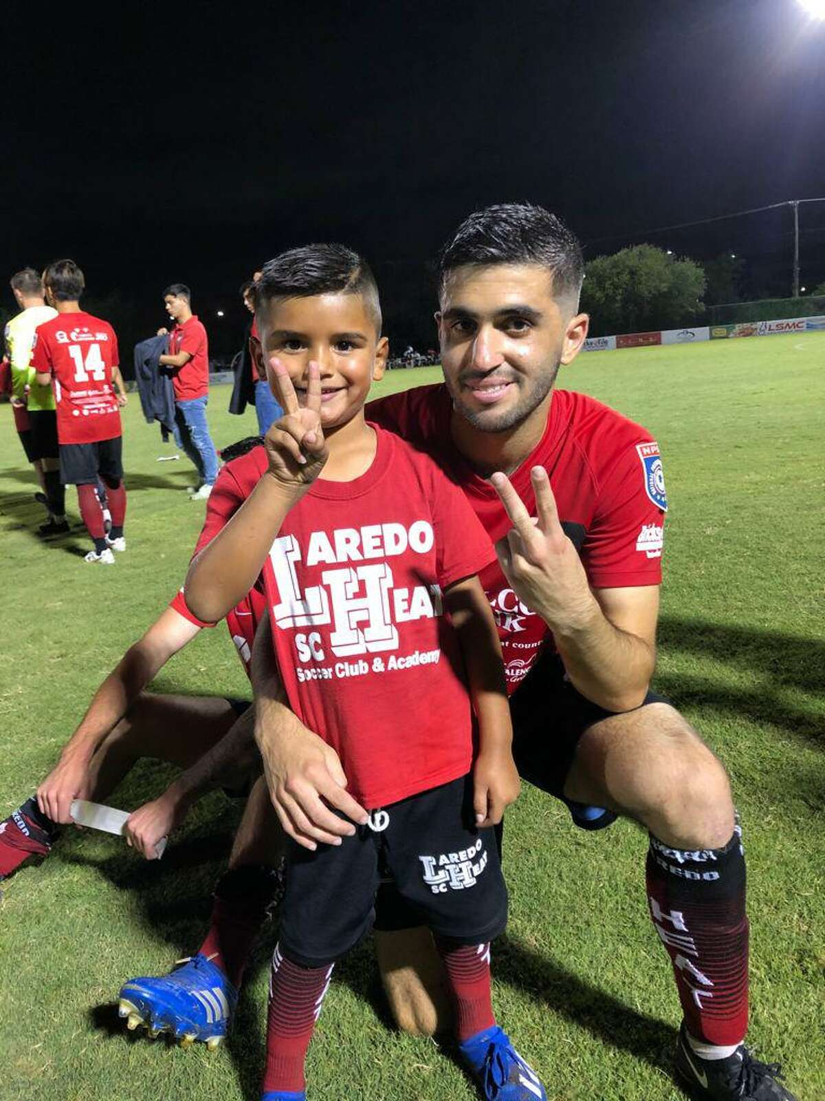 Laredo Heat SC forward Nadav Datner, pictured with youth player Jayden Garcia, is a finalist for the NPSL Team of the Month for May.