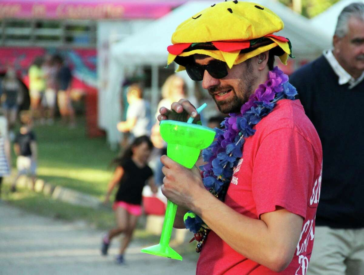 Caseville businesses and the chamber of commerce are anticipating a big summer for tourism as the pandemic fades and restrictions on crowd sizes, bars and restaurants are lifted. The Cheeseburger in Caseville festival, which returns Friday, Aug. 13, is just one of numerous events planned for the summer of 2021. (Tribune File Photo)