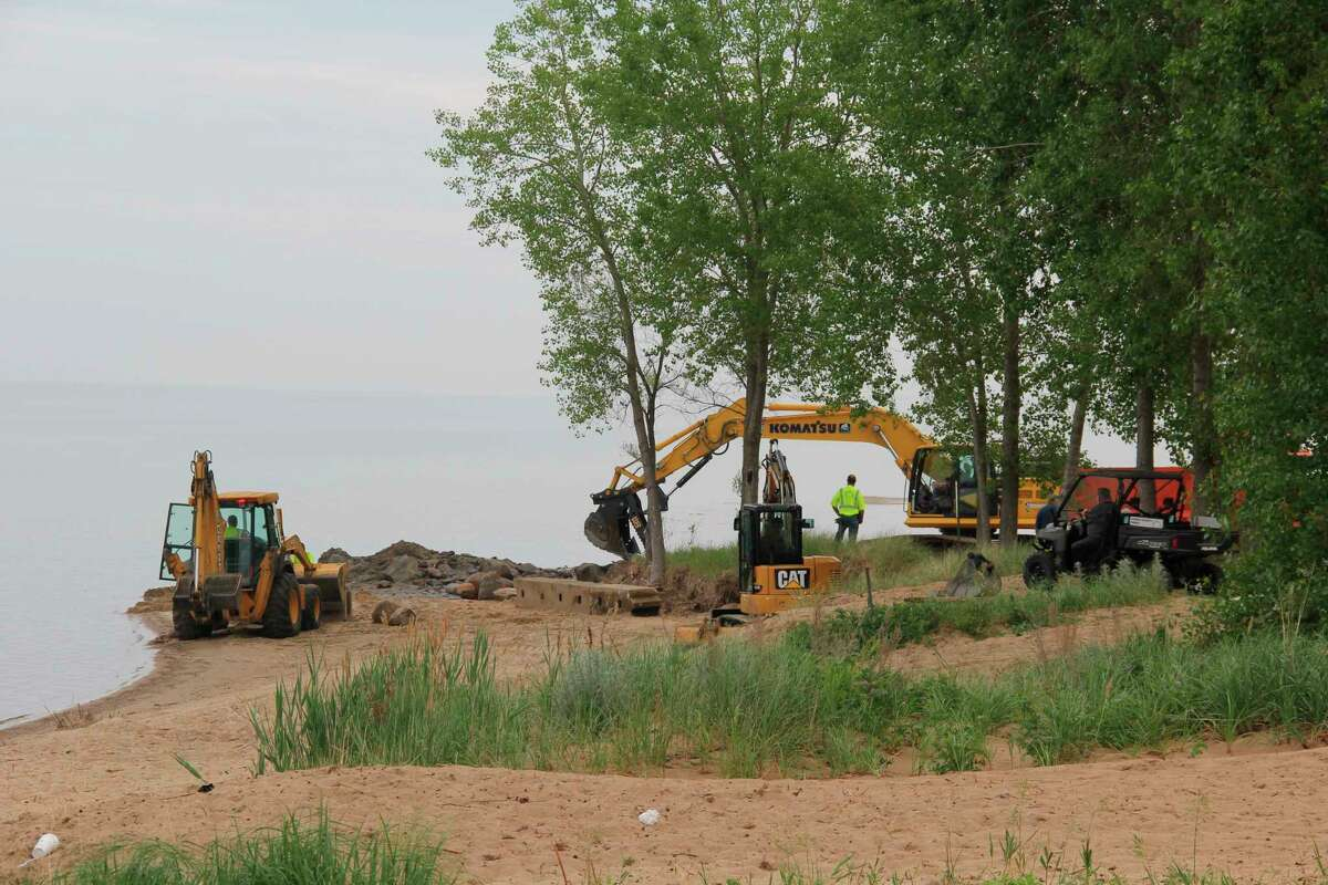 Huron County Road Commission workers remove the concrete that made up the Oak Beach boat launch on Tuesday morning. The launch has been closed for nearly a year due to safety concerns, according to the road commission. (Robert Creenan/Huron Daily Tribune)