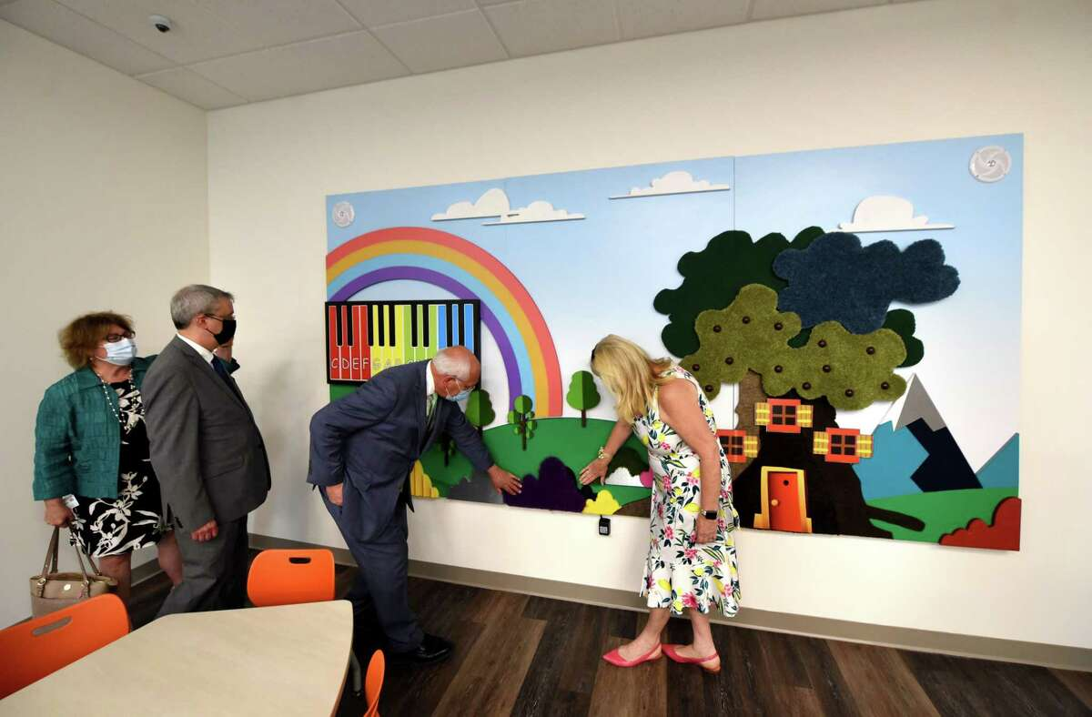 U.S. Rep. Paul Tonko experiences an interactive mural inside Ellis Medicine's new child and adolescent outpatient mental health clinic on Tuesday, June 8, 2021, during a ribbon cutting on State Street in Schenectady, N.Y. The project relocated its former child & adolescent outpatient mental health services into new space that is nearly twice as big. (Will Waldron/Times Union)