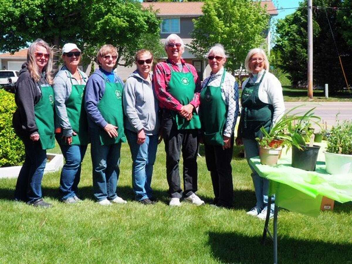 Members of the Spirit of the Woods Garden Clubrecently helped out at the annualplant sale. (Courtesy photo)