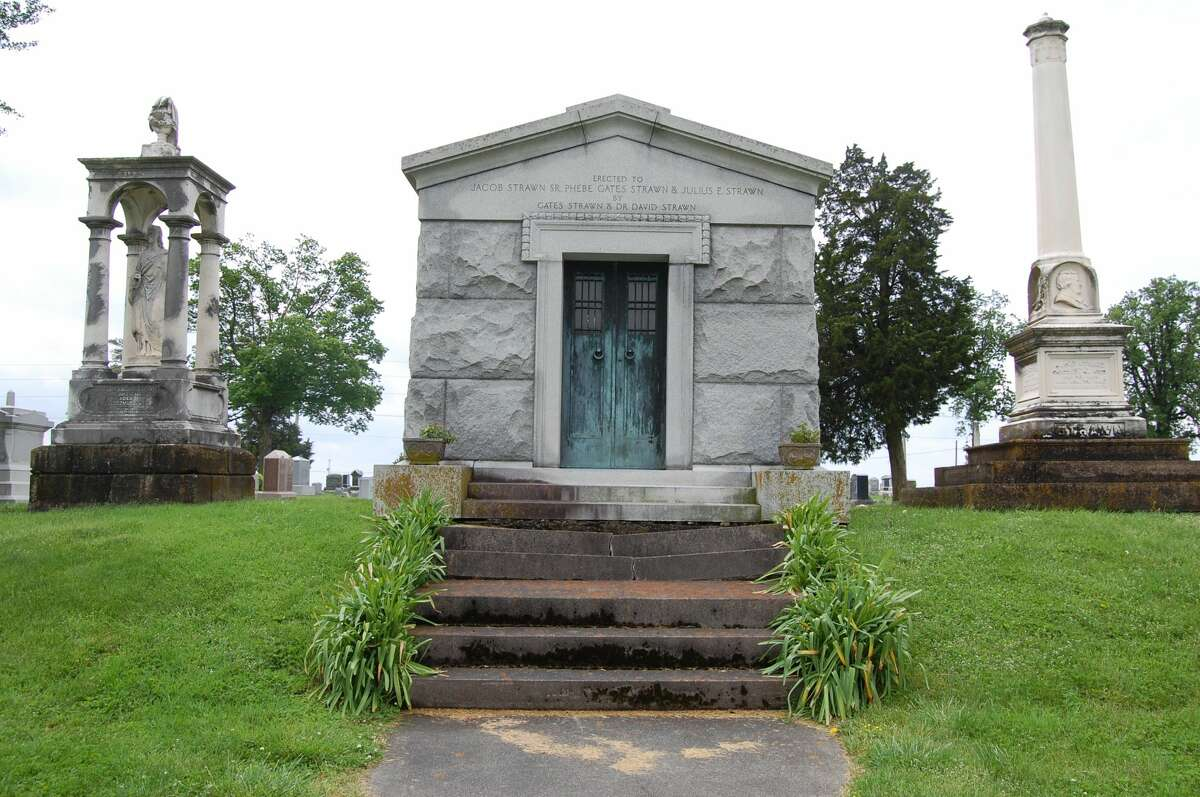 """The Strawn Family Plot is the final resting place of many members of the Strawn Family who were instrumental in acquiring land. Jacob Strawn, a very prominent citizen, was known as the """"Cattle King"""" as he acquired farm land raised cows."""