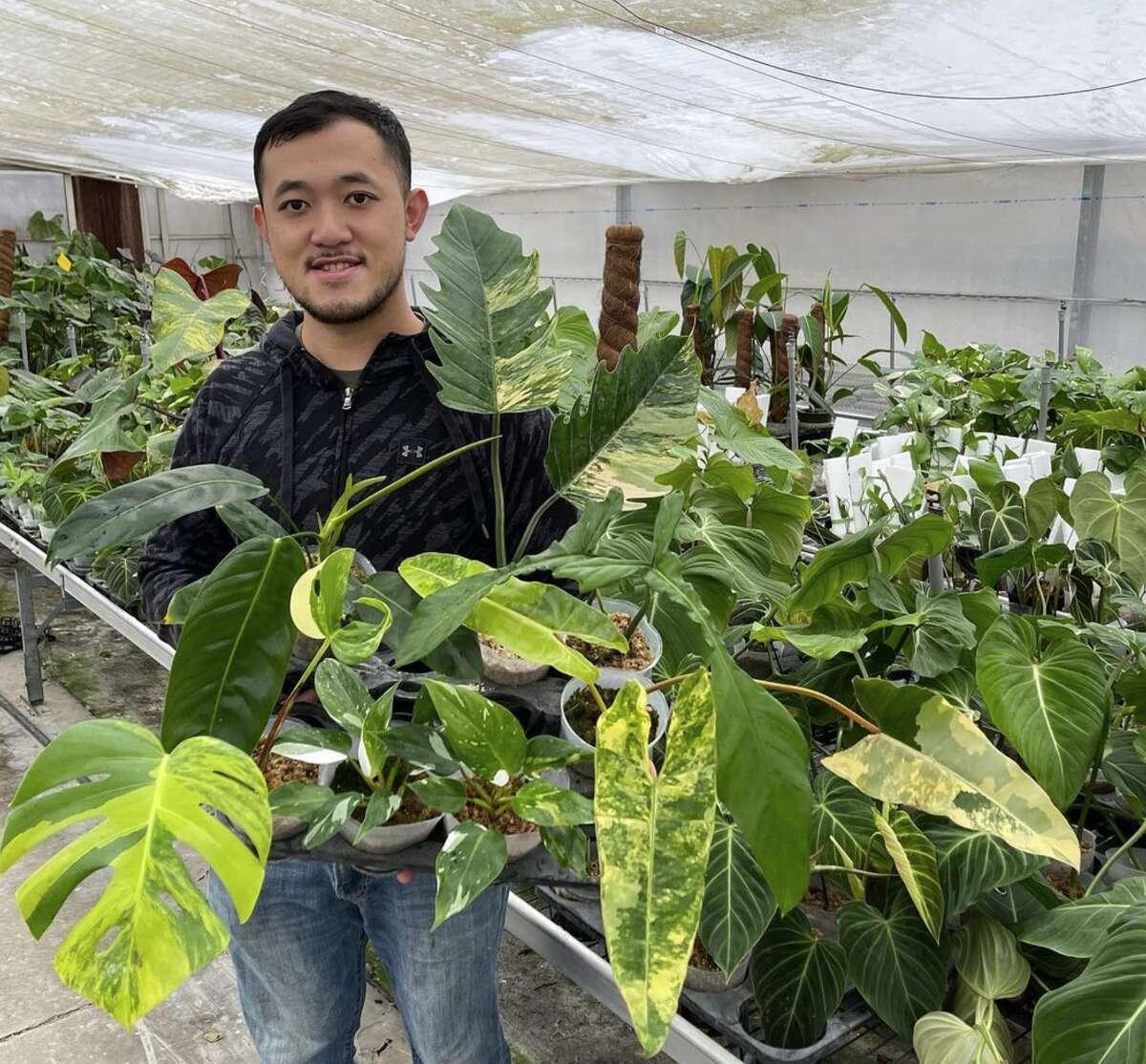 Bryan Wu poses in the Wuhoo greenhouse.