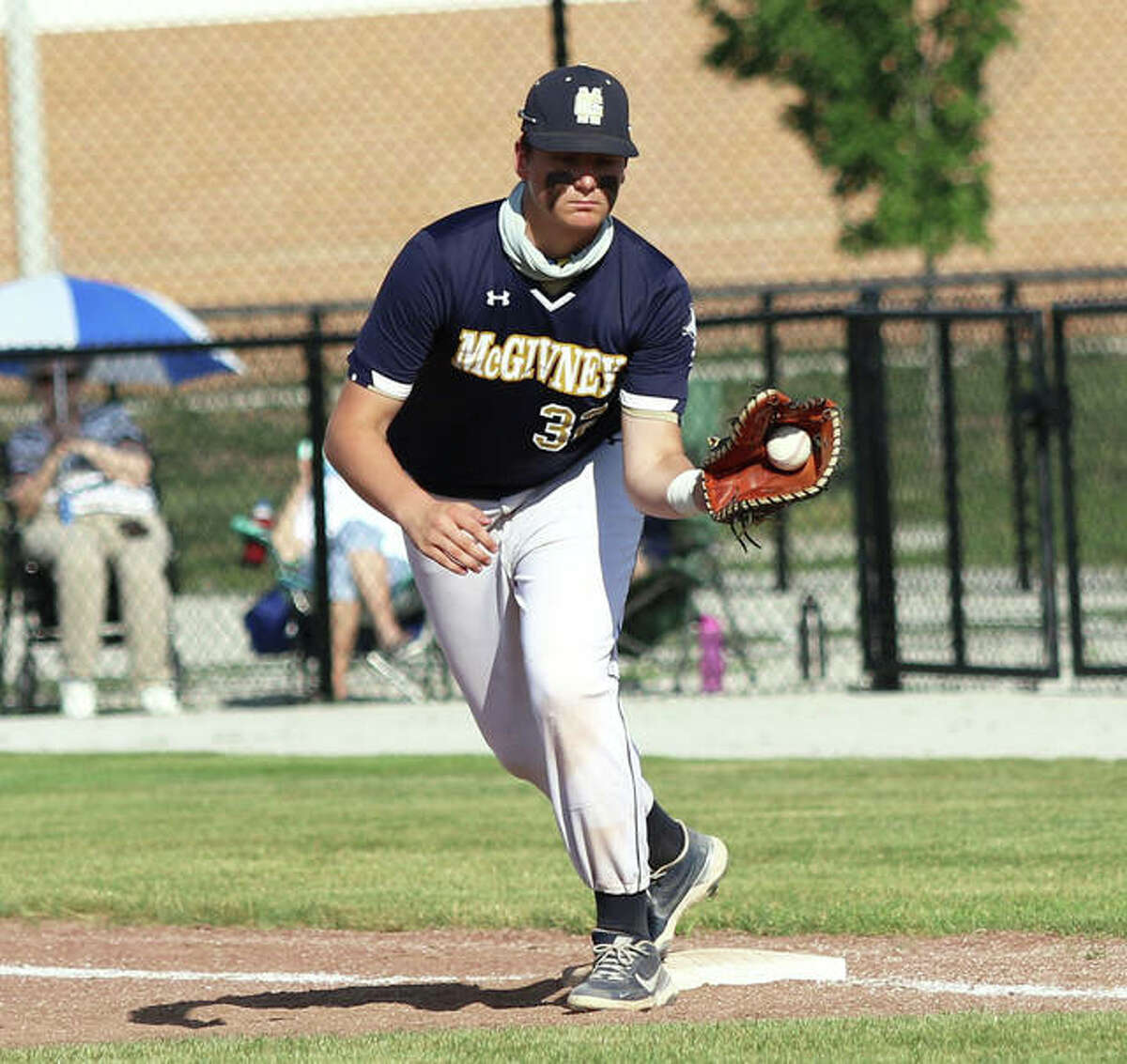 McGivney first baseman Gabe Smith takes a throw for an out against Metro-East Lutheran in a Class 1A regional title game Monday in Glen Carbon.