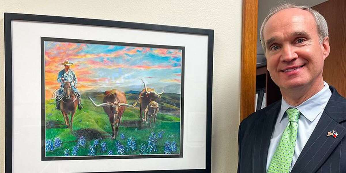 State District 132 Rep. Mike Schofield poses with Bridgeland High School freshman Jasmine Lu's rodeo artwork. Lu's artwork was one of two pieces selected to be displayed in Rep. Schofield's offices in Austin and Houston.