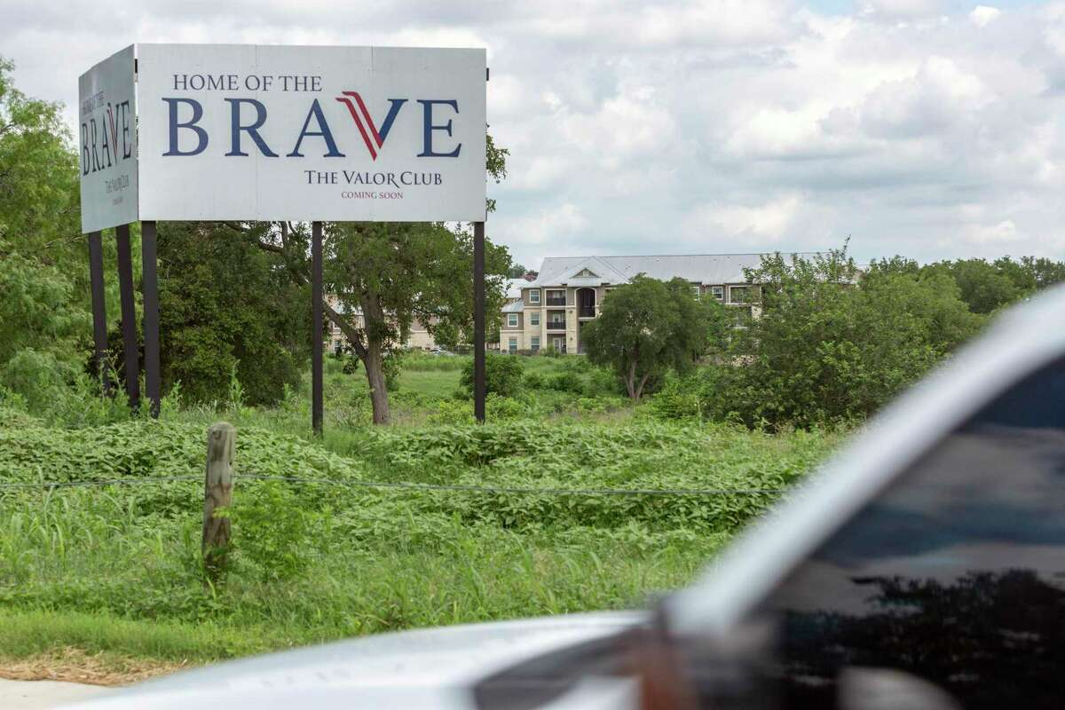 A sign for the Valor Club, a master-planned community at the site of the former Pecan Valley Golf Club on the Southeast Side, is seen June 2, 2021.