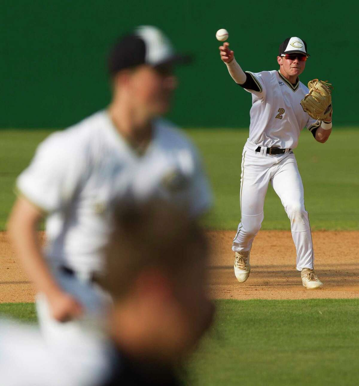 Conroe shortstop Tyler Linneweber (2) throws out Cole Davis #15 of Tomball Memorial in the fourth inning of a game during the Klein Tomball Tournament, Saturday, March 10, 2018, in Tomball.
