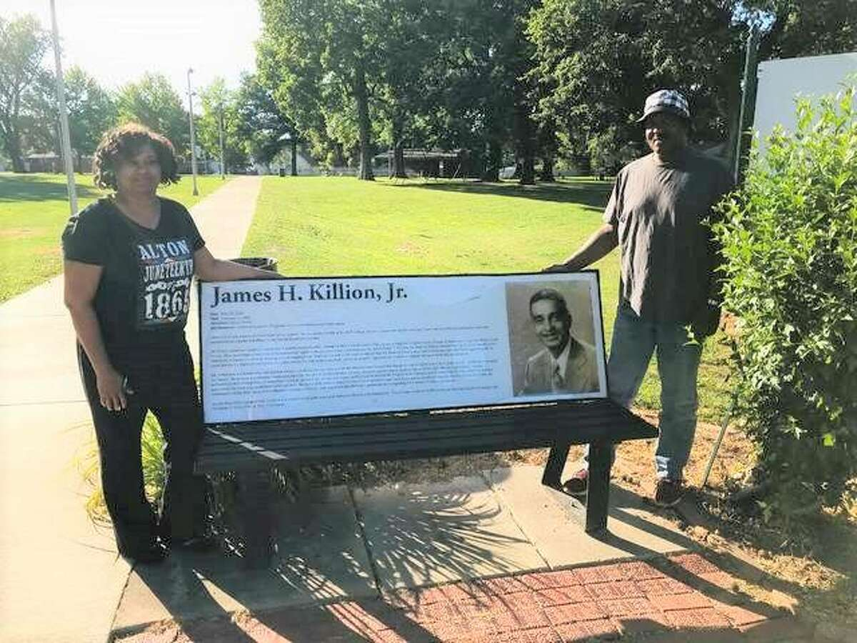 Alton Juneteenth Celebration committee member Marquato Rattler, left, and chairman Lee Barham, both of Alton, stand beside the namesake bench at James H. Killion Park at Salu in Alton. The 30th Annual Juneteenth Celebration is planned 10 a.m. to 5 p.m. Saturday, June 19, at the park.