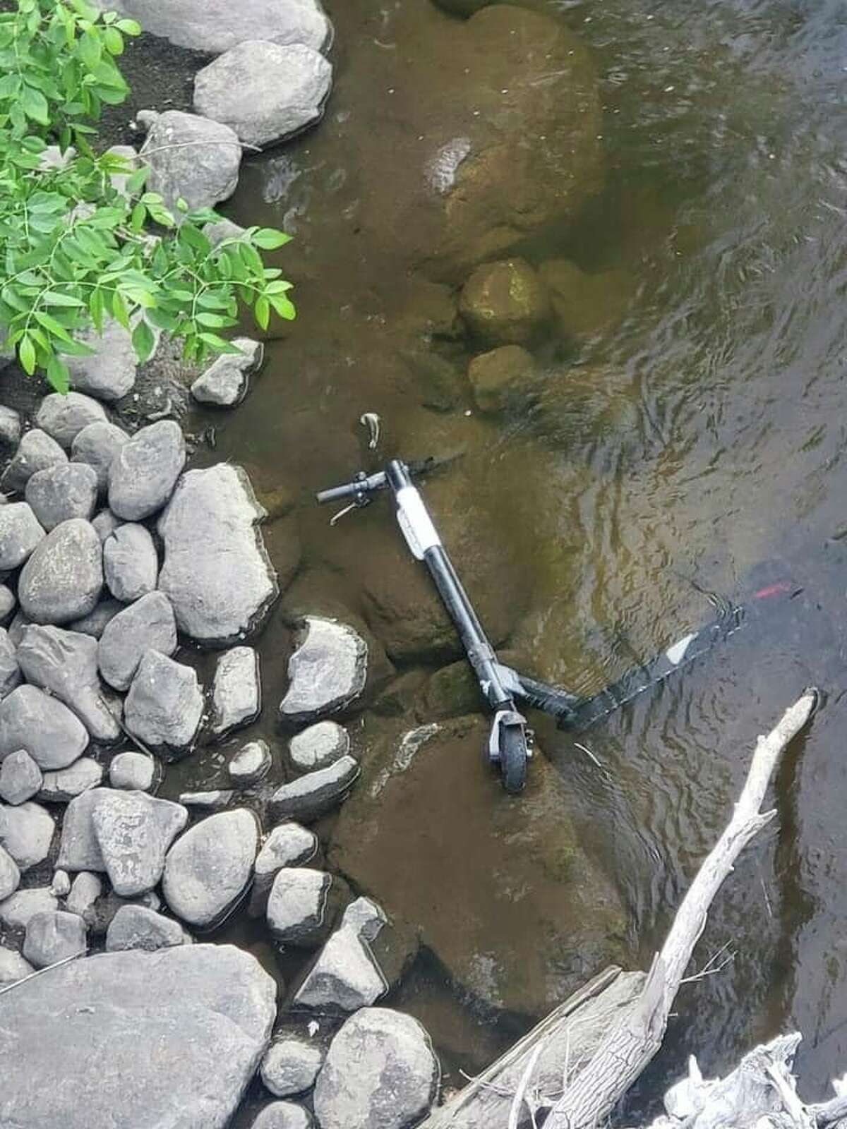 Concerns regarding misuse and negligent discarding of the Bird E-scooters was noted by residents with some scooters being found in the creeks and riverbanks in Big Rapids and others seen completely broken. (Submitted photo)