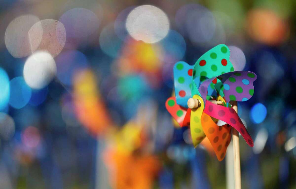 Volunteers and community members installed 2,322 pinwheels along FM 1488 and FM 2978, Thursday, April 22, 2021, in Magnolia. The annual installation by Children's Safe Harbor recognizes the number of child cases in Montgomery County and raises awarness of Child Abuse Prevention and Awareness Month.