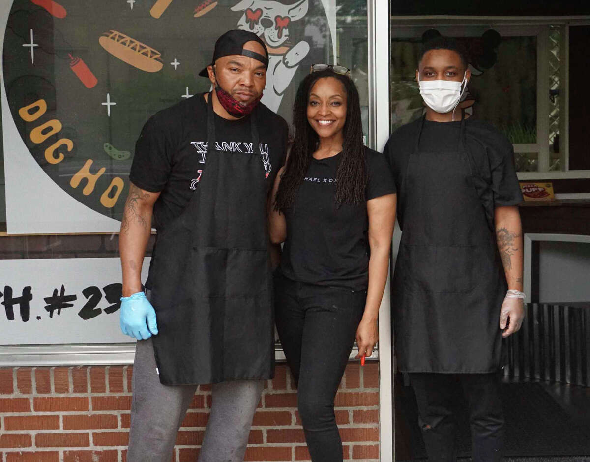 From left, Bernard Agee, Kacey Thompson-Agee and Emmitt Short IV stand in front of Fatty C's Dog House, Big Rapids' newest eating establishment. The eatery is located at 107 N. Warren Ave. and hosted its official grand opening this week.