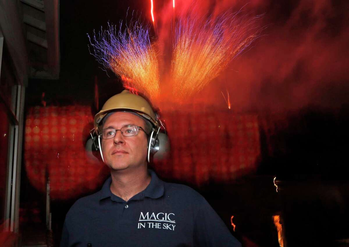 Jacob J. Dell, owner of San Antonio pyrotechnics company Magic in the Sky, watches as the June 6 fireworks show begins at Six Flags Fiesta Texas. His company lights up the sky over six states.