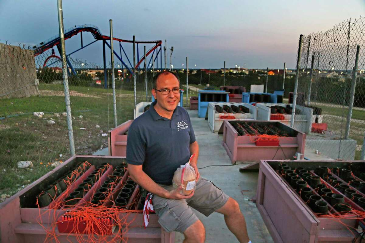 Jacob J. Dell, Magic in the Sky owner, checks the fireworks for the June 6 show at Six Flags Fiesta Texas. He says the work for a 20-minute show at night begins early that day.