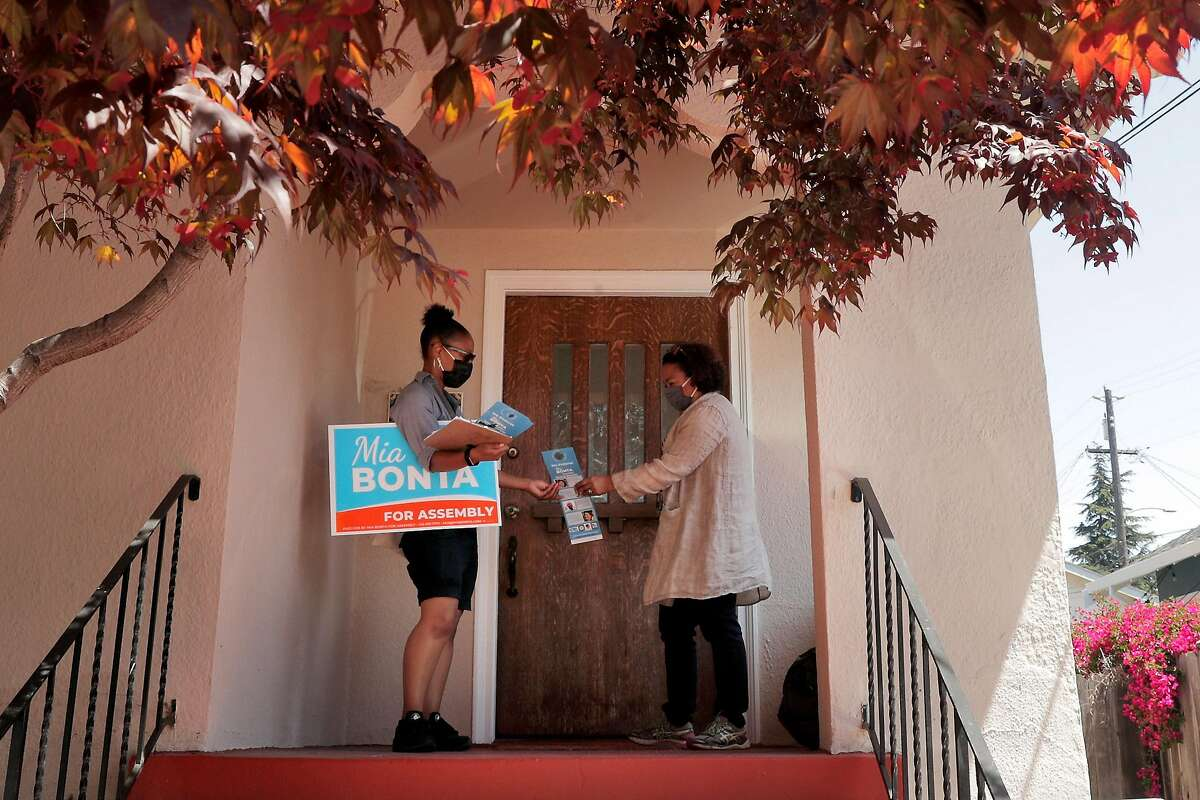Mia Bonta and campaign manager Rowena Brown canvass in Oakland's Glenview neighborhood.