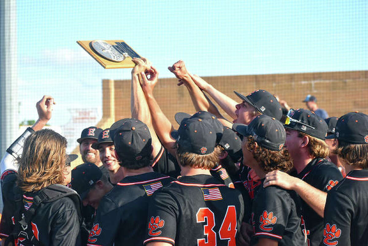 The Edwardsville Tigers celebrate with their plaque from a 2007 victory - the IHSA is not sending out regional plaques in 2021 - after rallying to beat Belleville West 6-5 Monday at Tom Pile Field to earn their state-record 33rd regional title.